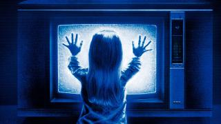 Carol Anne gets too close to the TV in Poltergeist