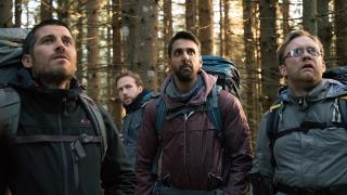 The four leads of The Ritual search the woods for answers