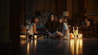 "Veronica and her siblings perform a seance in ""Veronica"""