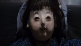 Creepy doll baby from Over Your Dead Body trailer